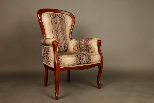 Old velour retro chair on gray room