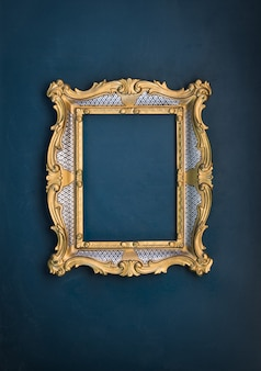 Old victorian gilded decorative frame on a green wall baroque rococo the renaissance