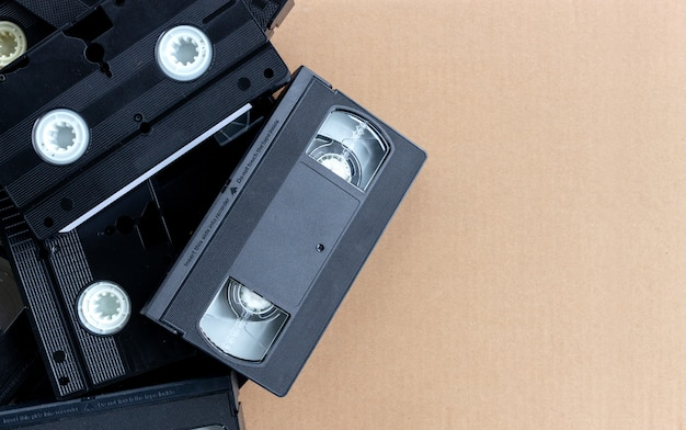 Old video tape on brown paper background. top view