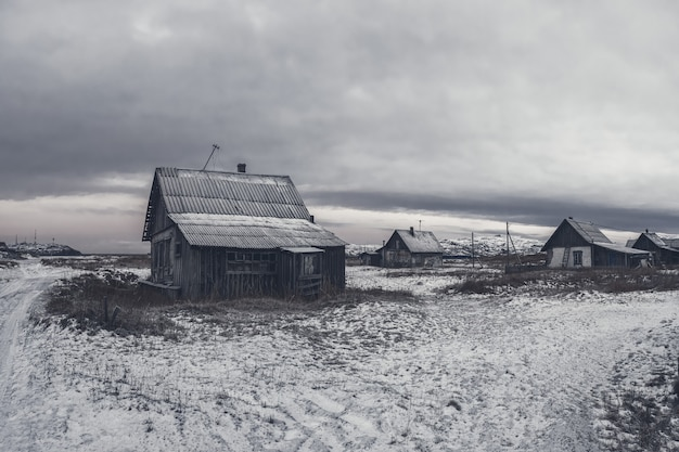 An old village in the polar north. view of the winter city of teriberka. russia. monochrome view.