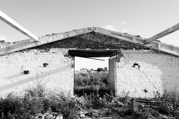 Old vintage abandoned building in ruins, evictions and abandonment - black and white