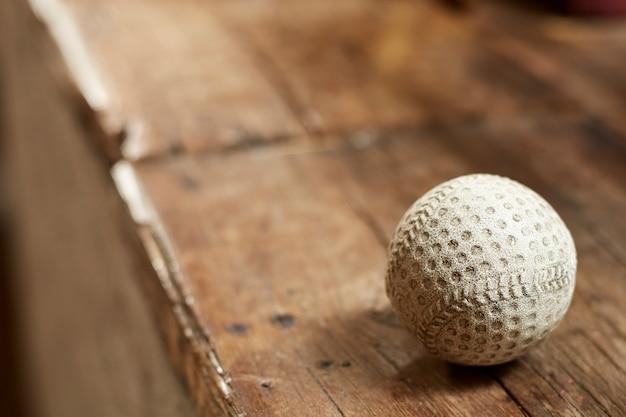 Old vintage baseball on wooden