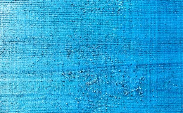 古いヴィンテージの青とベージュで塗装された木の板。傷のある素朴な背景の質感。