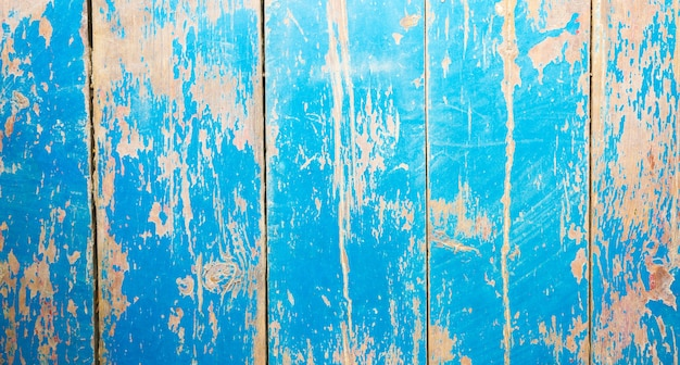 古いヴィンテージの青とベージュで塗装された木の板。素朴な背景の質感。