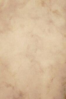 古いヴィンテージの茶色の紙羊皮紙の背景