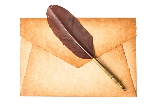 Old vintage burned envelope letter with quill feather pen isolated