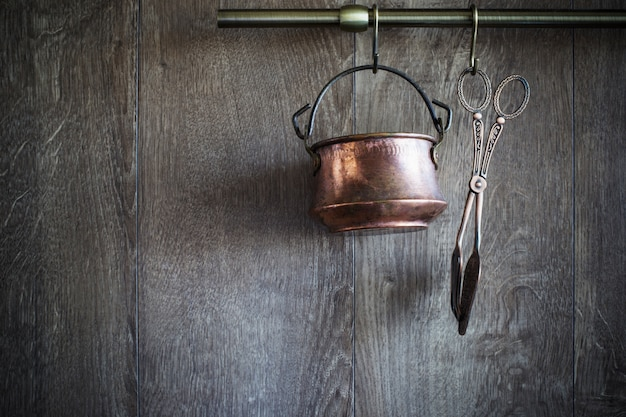 Old vintage dishware on dark wooden wall