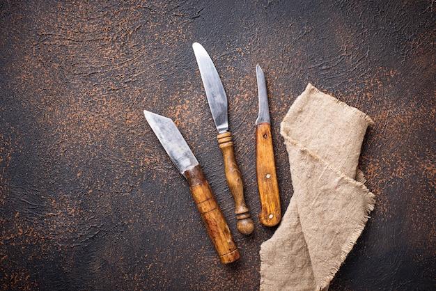 Old vintage knife on rusty background