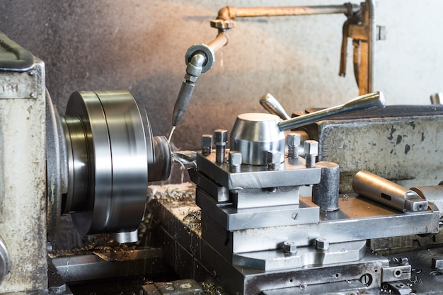 Old vintage lathe in the factory shop. metalworking plant.
