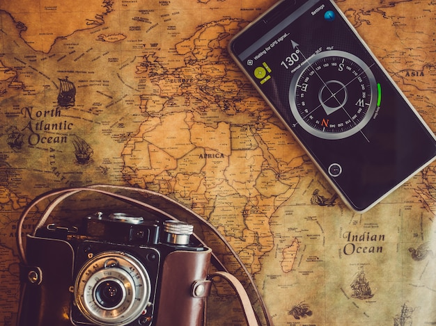 Old, vintage map and mobile phone. top view