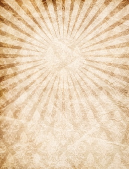 Old vintage paper with rays from the center texture background
