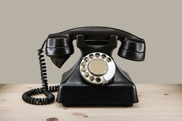 Old vintage phone with rotary dial