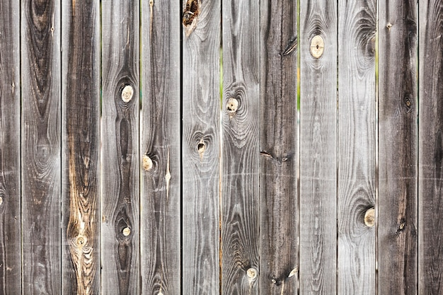 Old vintage planked wood board with holes