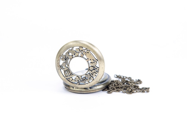 Old vintage pocket watch isolated on white