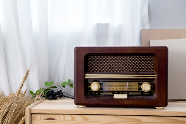 Old vintage radio with shelf on the wooden cabinet