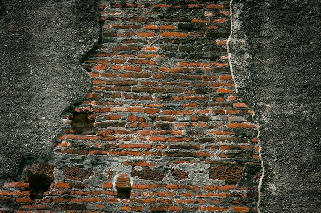 Old vintage red brick wall repair by cement, crack brick wall texture background