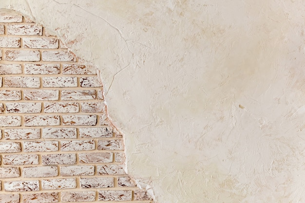 Old vintage red brick wall with crashed white plaster texture background white retro building