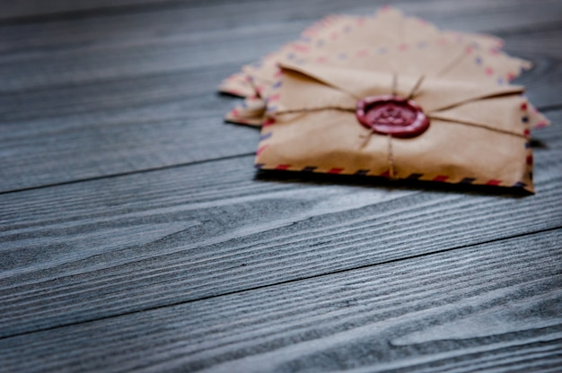 Old vintage retro envelopes with a wax stamp on old dark brown wooden table