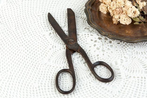 Old vintage scissors and vintage metal plate