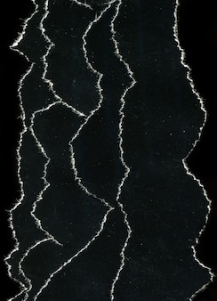 Old vintage torn black paper texture