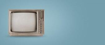 Old vintage tv on colour background