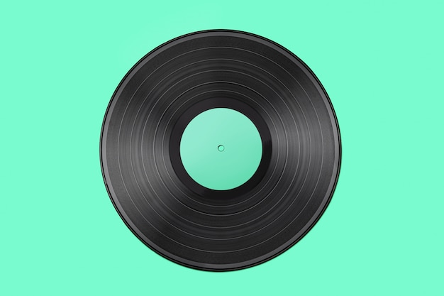 Old vintage vinyl record isolated on turquoise  background