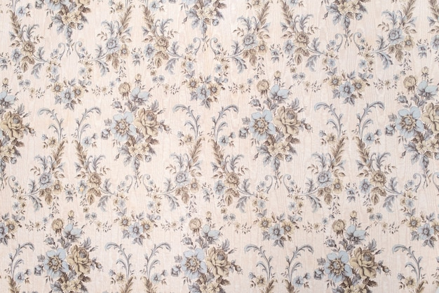 Old vintage wallpaper with a pattern of flowers