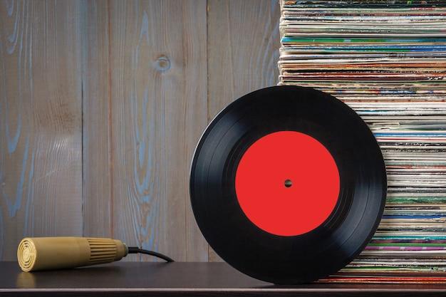 Old vinyl discs and microphone