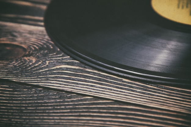 Old vinyl record on the wooden table