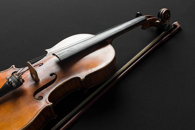 Old violin on a black