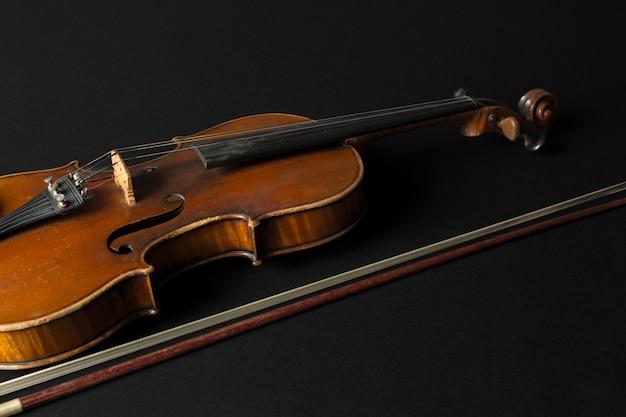 Old violin on black