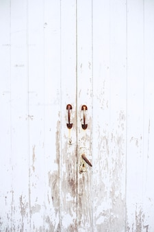 Old vitage wooden white door with old latch handle