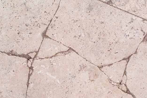 亀裂のある古い壁の背景コンクリート表面