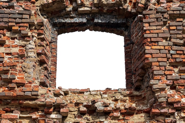Old wall made of old bricks with a hole in the middle. isolated on white background. grunge frame. horizontal frame. high quality photo