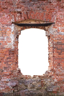 Old wall made of old bricks with a hole in the middle. isolated on white background. grunge frame. vertical frame. high quality photo