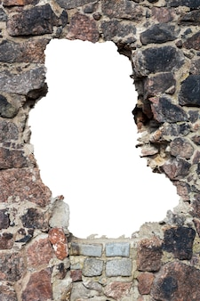 An old wall of natural stone with a hole in the middle. vertical frame. high quality photo