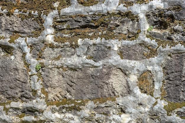 石の古い壁のクローズアップ、背景、テクスチャ