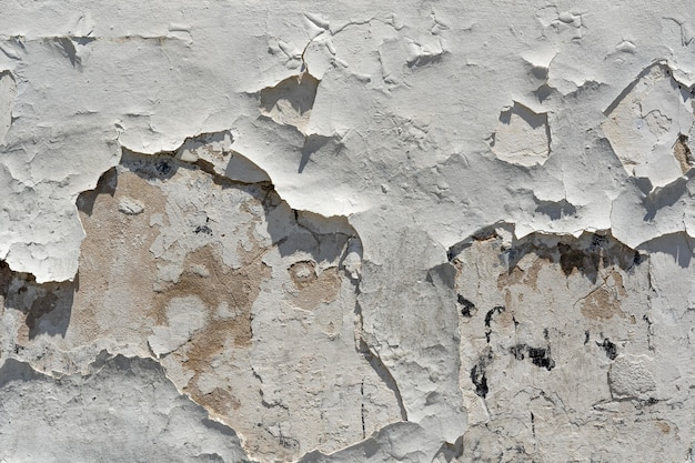 Old wall with falling paint