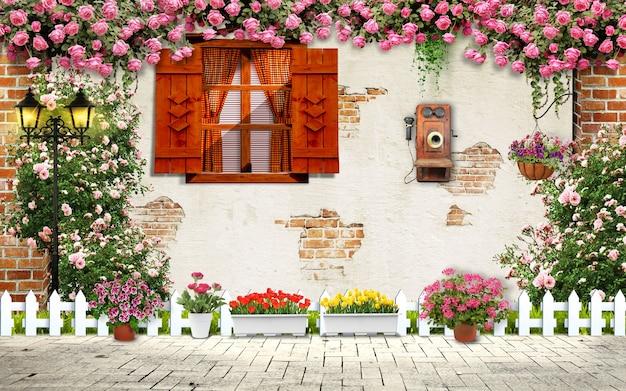 窓と花のある古い壁。外の家の装飾の床の古い電話と花瓶