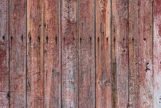 Old, weathered and aged wooden door with lines and cracks Free Photo