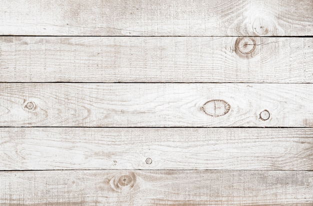 Old weathered wooden plank painted on white