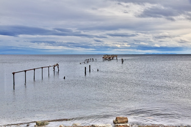 Old wharf in the harbor of punta arenas, patagonia, chile