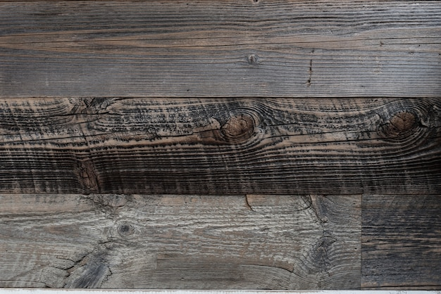 Old wheathered teak wooden wall texture background