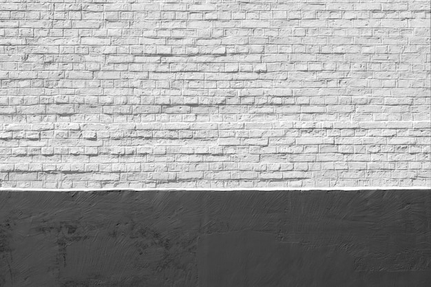 Old white and black brick wall background