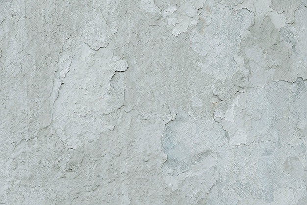 Old white cracked painted wall background texture