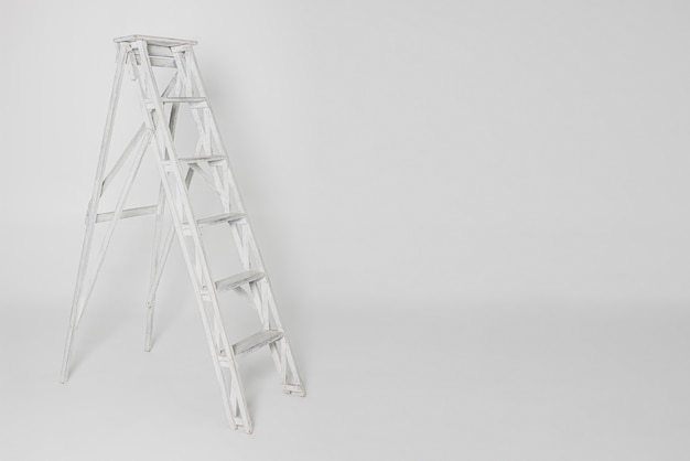 Old white ladder isolated on white background