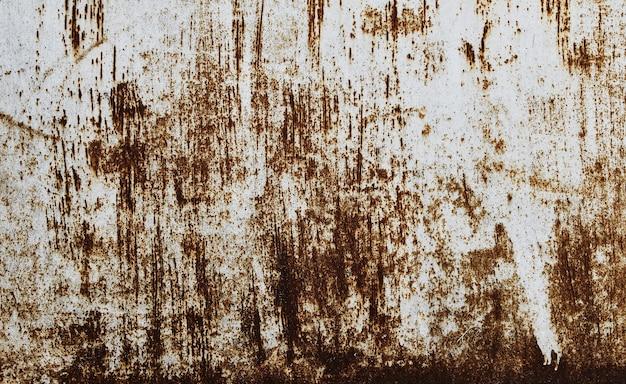 錆びた質感の古い白い塗られた壁。グランジ錆びた金属の背景。さび汚れ。