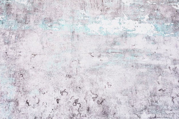 Старый белый с синей текстурой, отслаивающийся от бетонной стены для фона