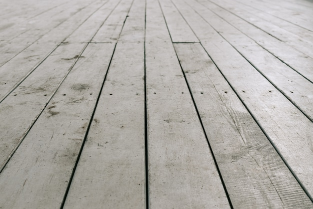 Old white wooden planks on the floor