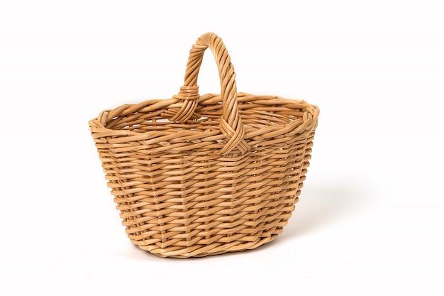 Old wicker basket on white